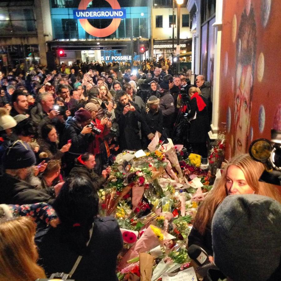 Bowie fans paying their respects outside the Aladdin Sane mural in Brixton